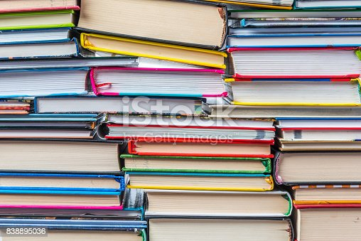 istock Stack of books on a shelf, multicolored book spines. 838895036