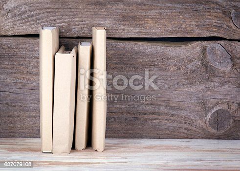 1034955096 istock photo Stack of books on a wooden table 637079108