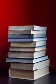 stack of books on red background closeup