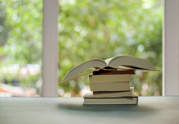 Stack of books on table stock photo
