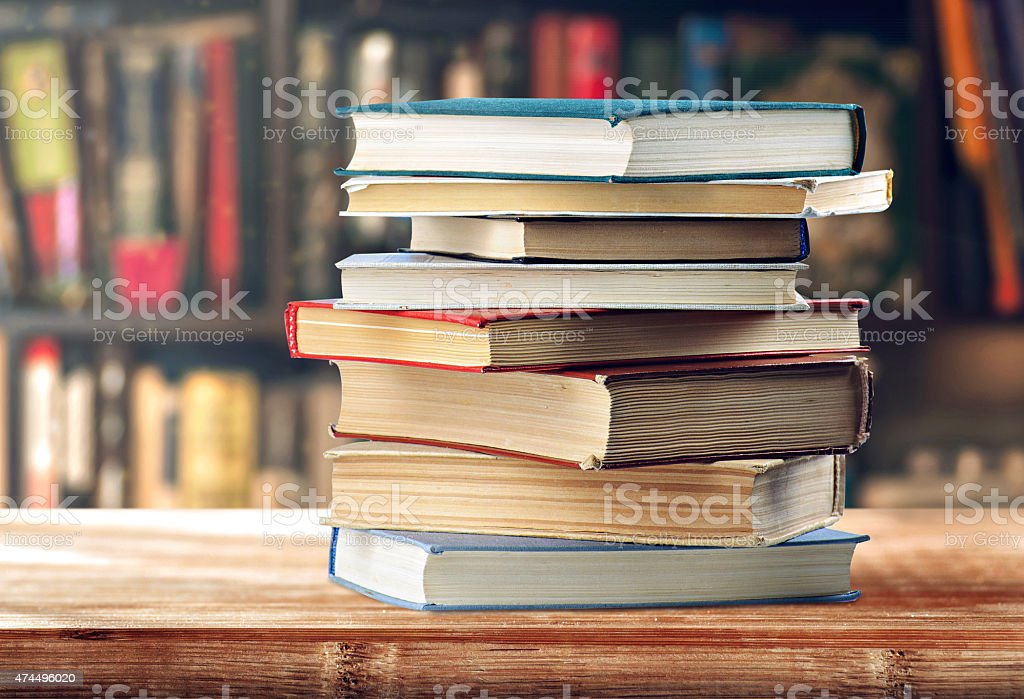 stack of books on the shelf stock photo