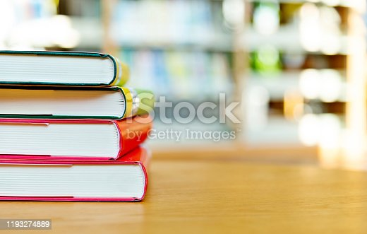Stack of  books on the table of public library.