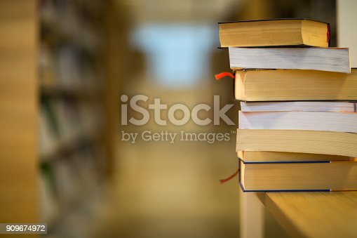 istock Stack of books on the table 909674972