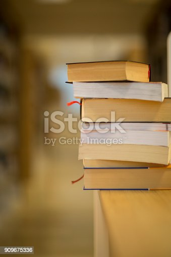 istock Stack of books on the table 909675336