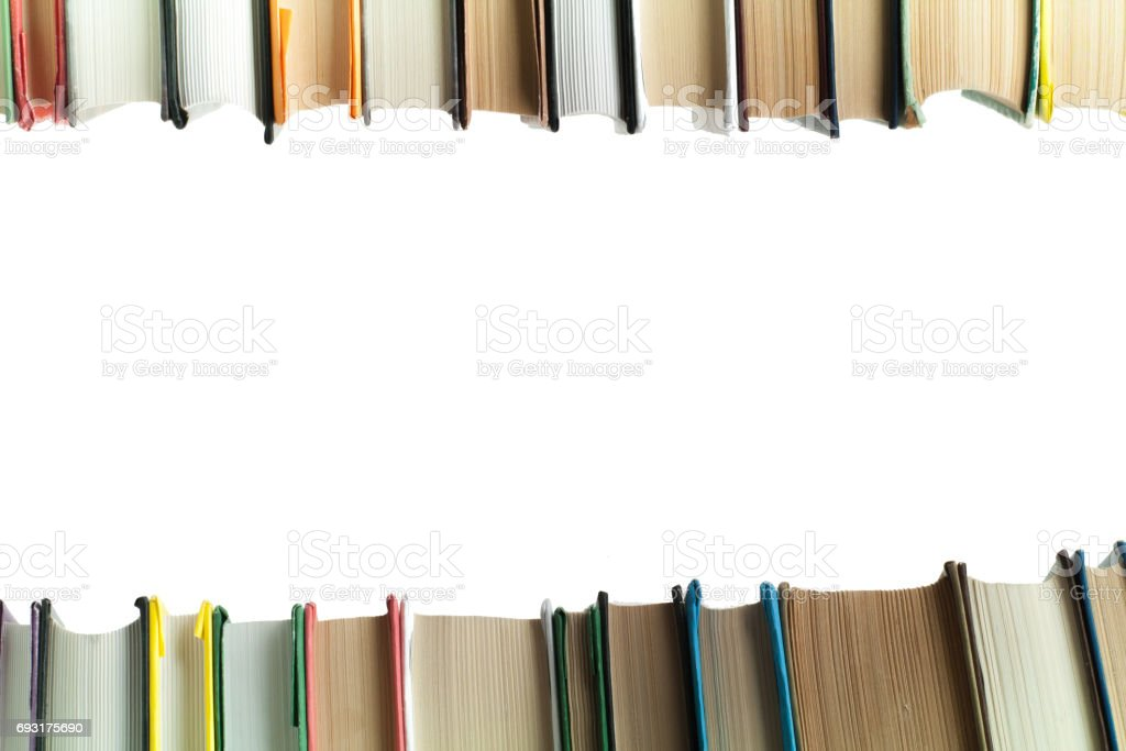A stack of books on white background. Copy space for your text. Ideas for business and self-development. Study background stock photo