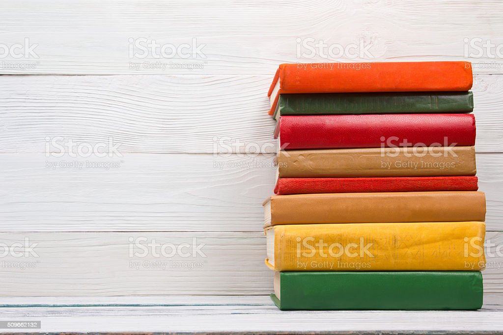 Stack of books on wooden table. Back to school. Copy stock photo