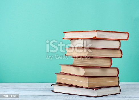 istock Stack of books on wooden table. Education background.Back to school. Copy spase for text. 890160616