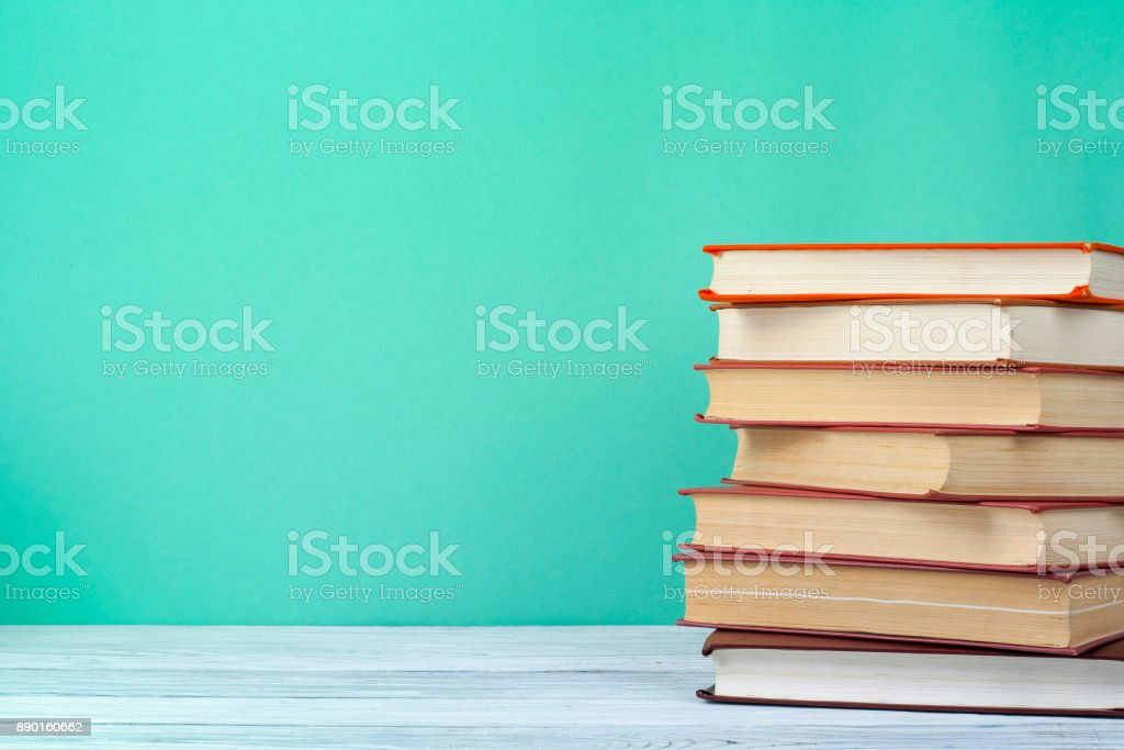 Stack of books on wooden table. Education background.Back to school. Copy space for text. stock photo