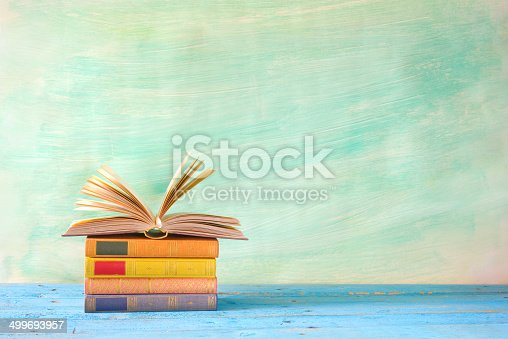 508711370 istock photo stack of books, one opened 499693957