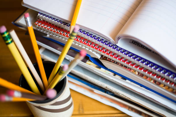 Stack of books or paper work at home office or home schooling stock photo
