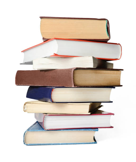 stack of books A stack of books on a white isolated background. stack stock pictures, royalty-free photos & images