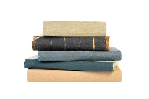 A stack of old books isolated on a white background. Back to school and education concept.