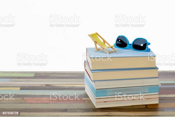 Stack of books with blue sun glasses and yellow deck chair on top picture id837506728?b=1&k=6&m=837506728&s=612x612&h=mxcnxxfqaxyti2wbeuyftt4rwzbjgc6lhyw9buwv1g8=