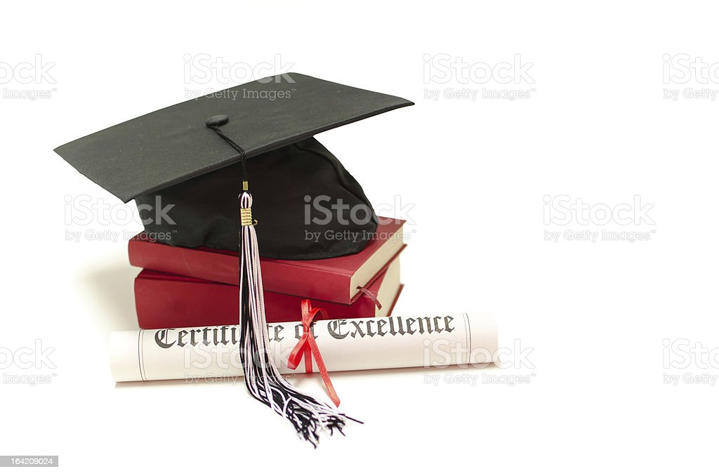 Stack of books with cap and diploma on white background royalty-free stock photo