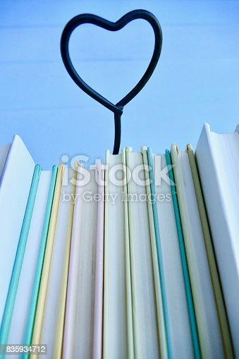 istock Stack of books with heart symbol behind 835934712