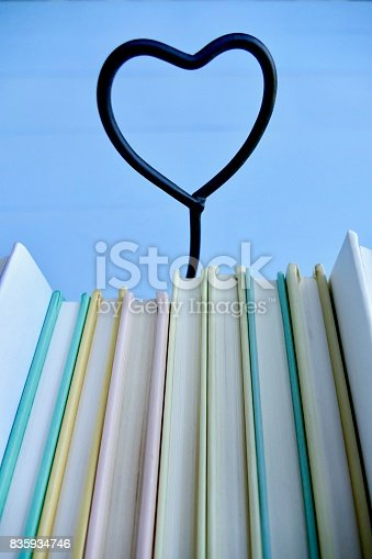 istock Stack of books with heart symbol behind 835934746
