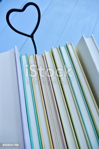 istock Stack of books with heart symbol behind 835934766