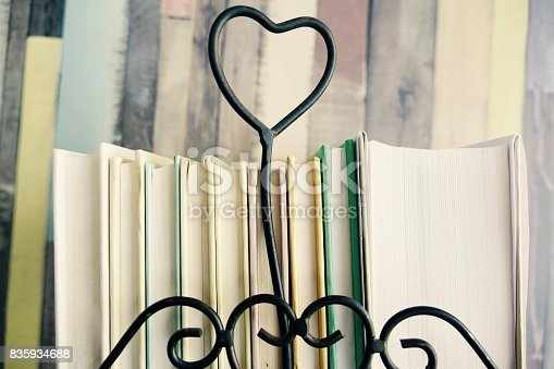 istock Stack of books with heart symbol 835934688