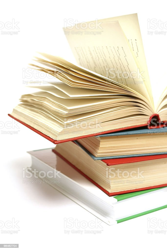 Stack of books with opened book royalty-free stock photo