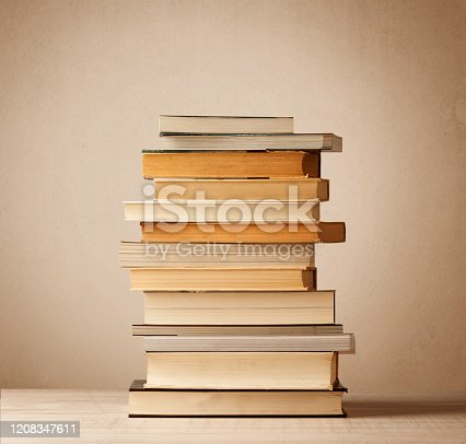 1034955096 istock photo A stack of books with vintage background 1208347611