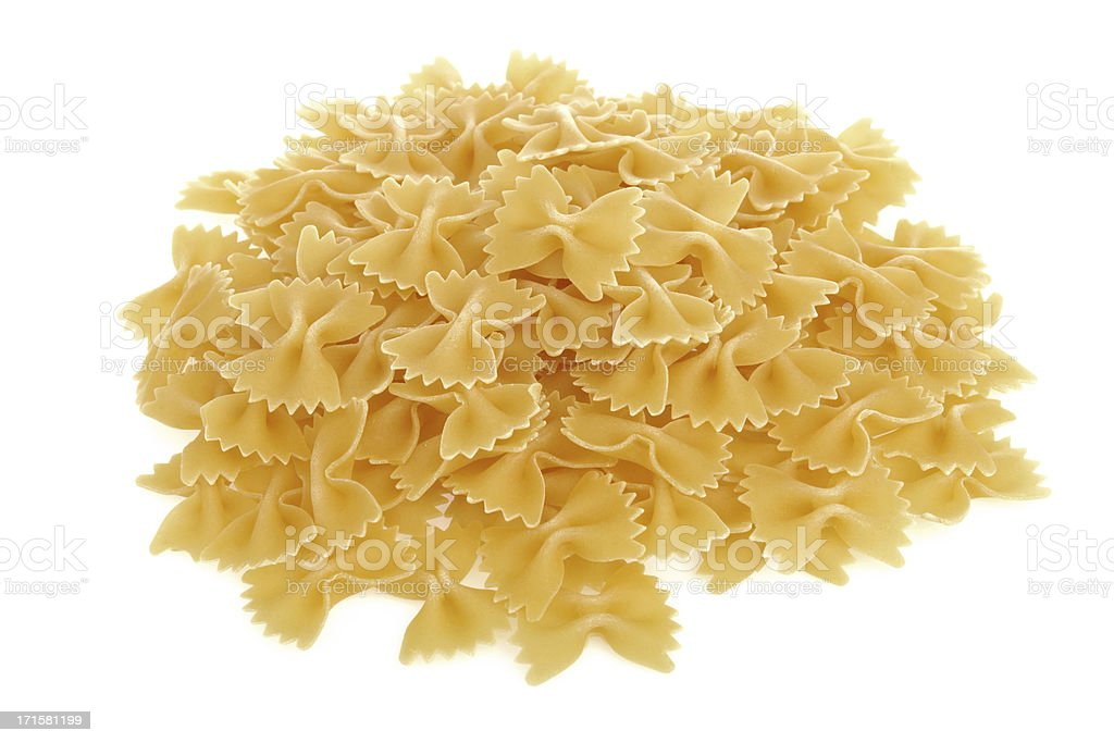 Stack of bow tie pasta on white background royalty-free stock photo