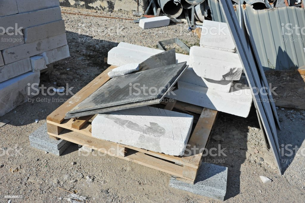 Stack of brick and material waste stock photo