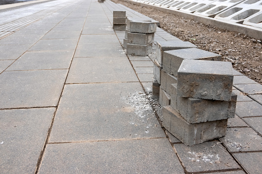 Stack of bricks on the sidewalk. Pavement renewal project in the city.
