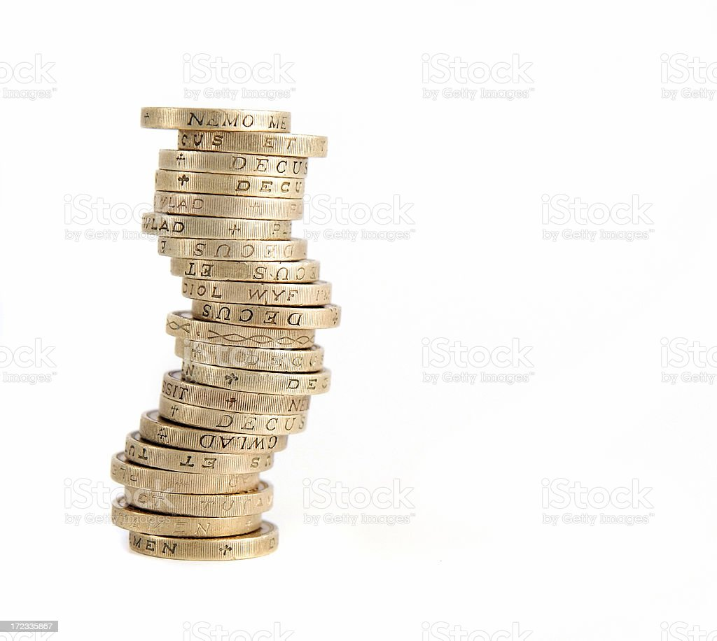 Stack of British pound sterling coins on a white background stock photo