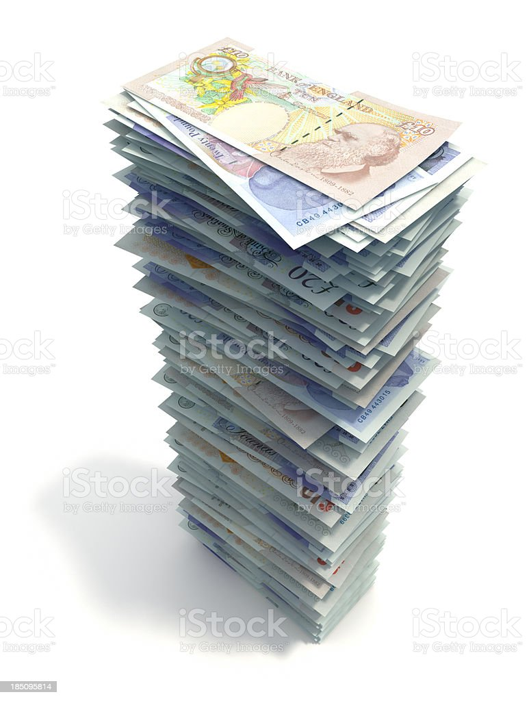 Stack of British pounds isolated on a white background stock photo