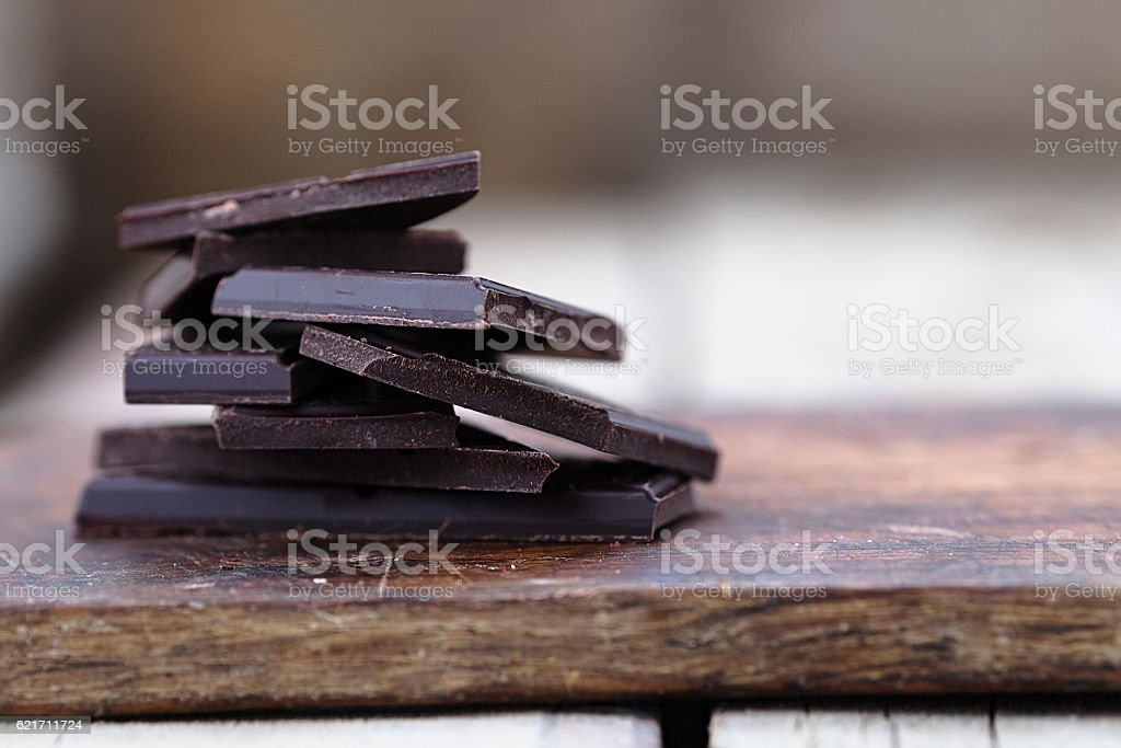 Stack of broken chocolate bar pieces stock photo
