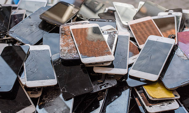 stack of broken screens - broken iphone stock photos and pictures