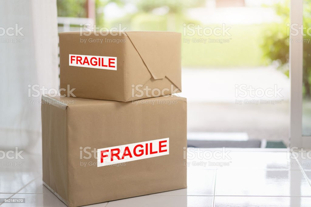 Stack of brown cardboard boxes, fragile box, Fast and reliable...