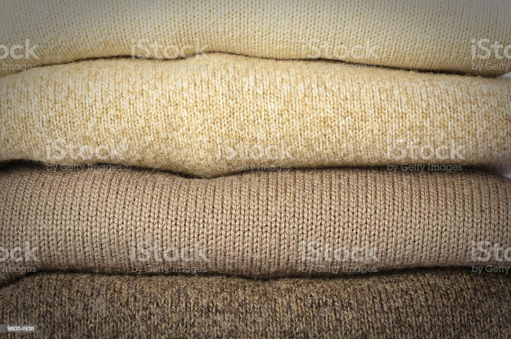Stack of brown sweaters royalty-free stock photo