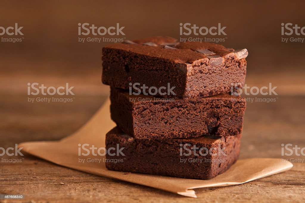 Stack of Brownies on Wood stock photo