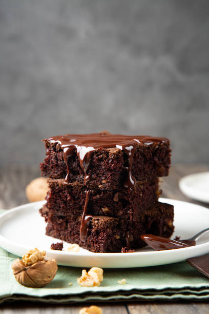 Stack of brownies with melted chocolate stock photo