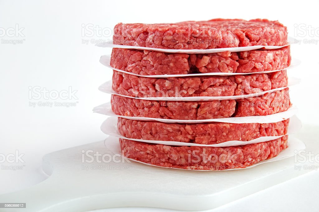 Stack of burger patties stock photo