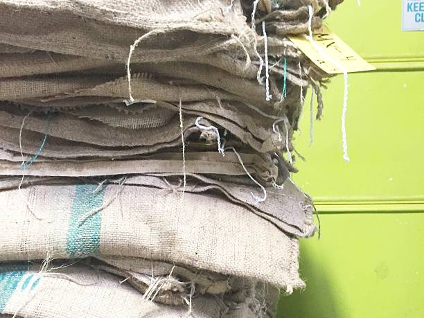 Stack of burlap coffee sacks stock photo