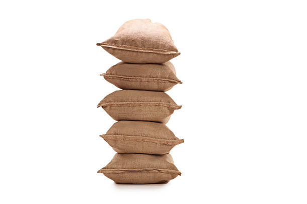 stack of burlap sacks - sack stock pictures, royalty-free photos & images