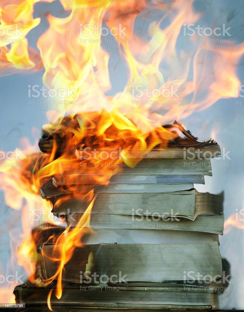 stack of burning books royalty-free stock photo