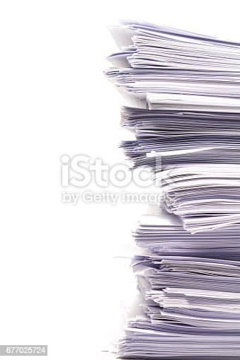 istock Stack of business papers isolated on white background 677025724