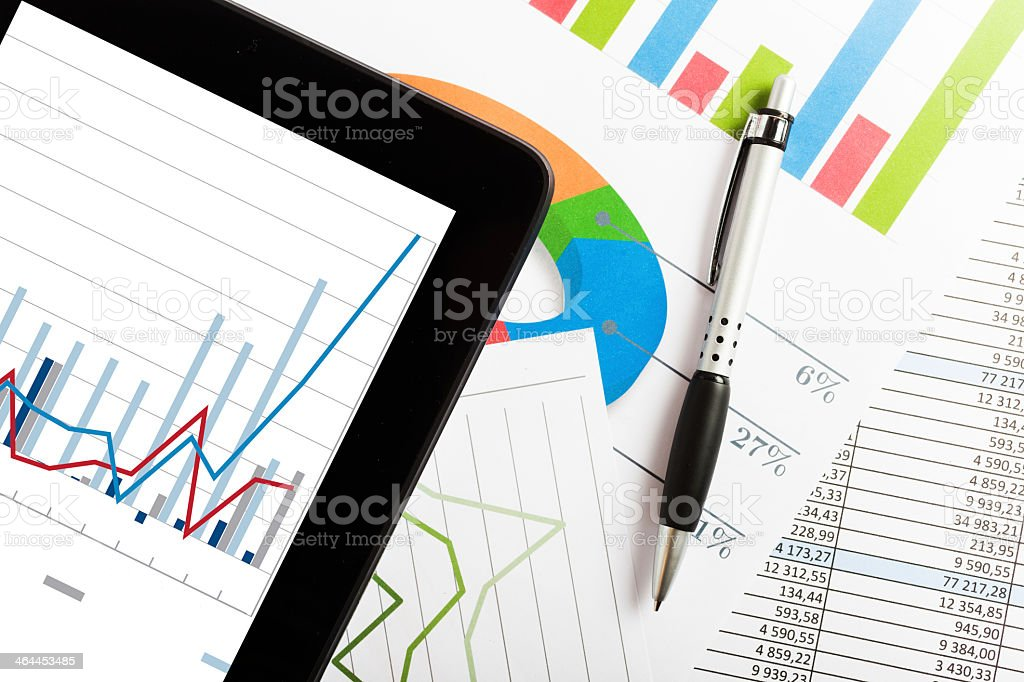 A stack of business reports with charts and graphs stock photo