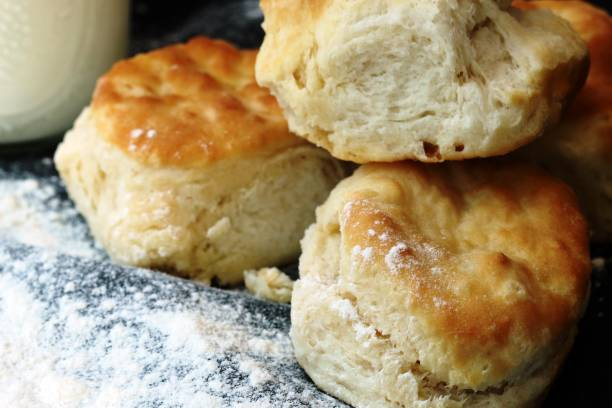 Stack of Buttermilk Biscuits Stack of three buttermilk handmade biscuits from scratch with flour biscuit stock pictures, royalty-free photos & images