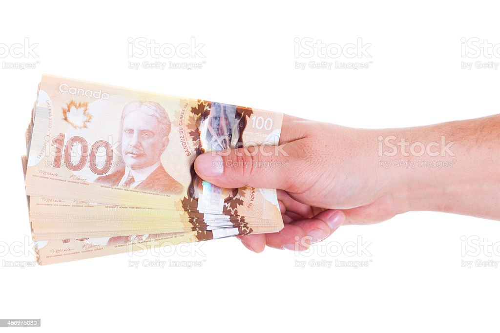 Stack of Canadian $100 bills stock photo
