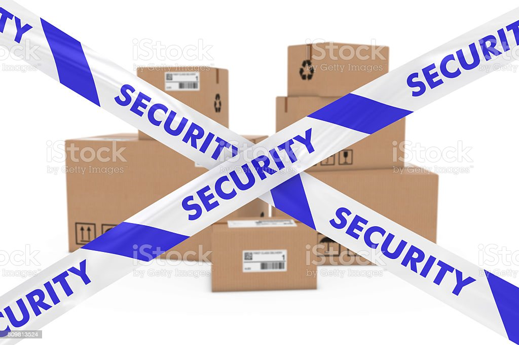 Stack of Cardboard Boxes behind Security Tape Cordon stock photo