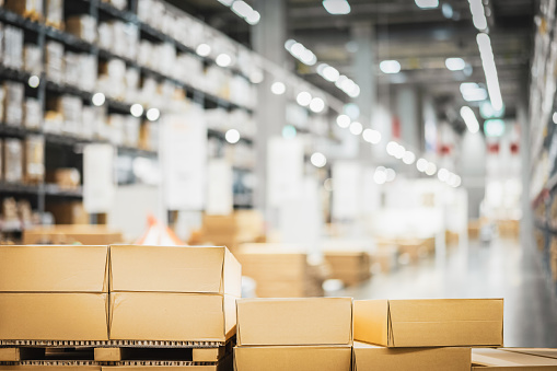 Stack of cardboard boxes in smart warehouse industry logistic.