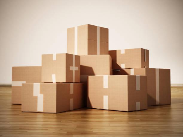 stapel von kartons auf parkettoberfläche abgedeckt stehen - umzug transport stock-fotos und bilder