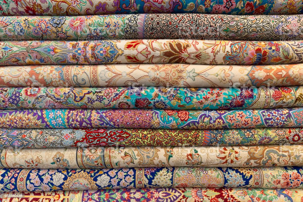 Stack of carpets stock photo