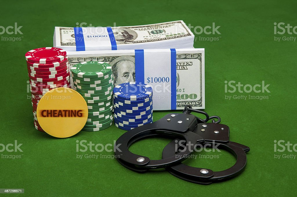 Stack of cash with poker chips stock photo