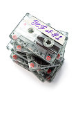 Stack of  cassette tapes, isolated on white without plastic cases.  Selective focus.Shot with a tilt shift lens.