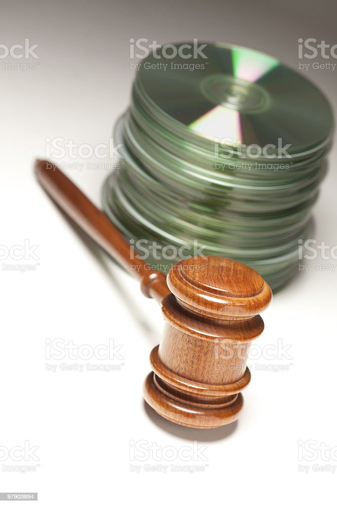 Stack of CD Rom or DVD Discs and Gavel royalty-free stock photo